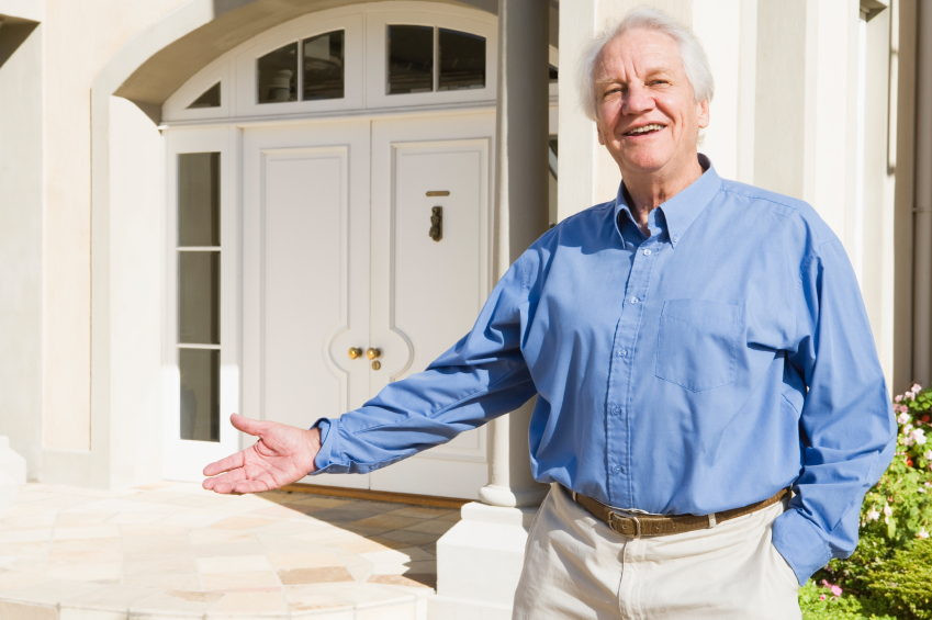 Senior man standing outside house
